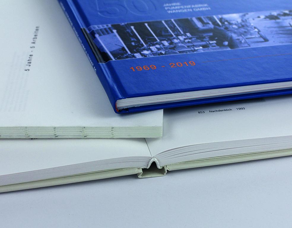Hardcover und offene Fadenheftung